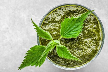 Detox juice or green smoothie, healthy drink with leaves of nettle Banco de Imagens