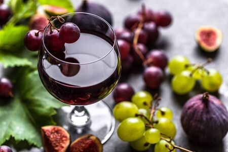 Fresh fruit and wine. Glass of red wine with grapes.