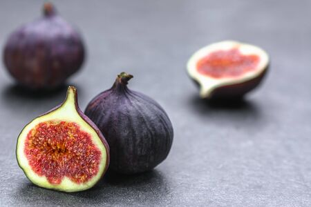 Fresh fig fruit. Blue figs on dark background.