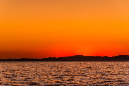 Orange sunset on sea horizon, landscape, Dalmatia, Croatia Banco de Imagens