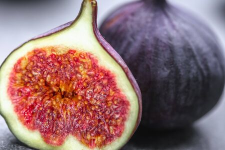 Fresh figs. Purple slice of fig fruit, closeup