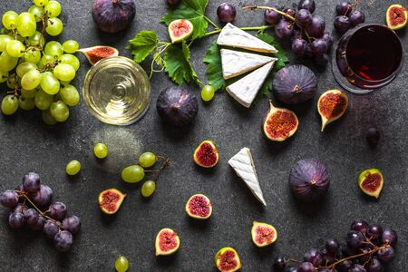 Buffet with wine snack, mediterranean appetizer: wine, cheese and fruit.