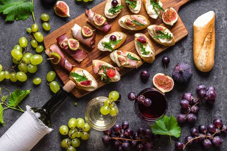 Mediterranean snack for wine. Traditional tapas bar, spanish table with food, platter with appetizer or italian bruschetta. Banco de Imagens