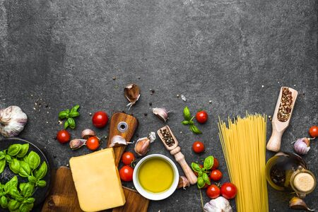 Italian food ingredients of spaghetti bolognese: pasta, tomatoes, basil, parmesan, herbs and spices