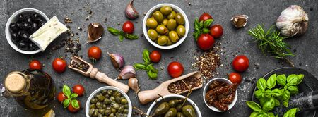 Mediterranean food background with herbs, olive, oil, tomatoes, basil Banco de Imagens