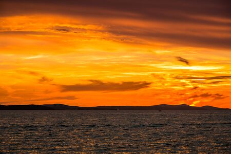 Golden sky with sunset over the sea, landscape from the beach in Zadar, Dalmatia, Croatia, Europe Banco de Imagens