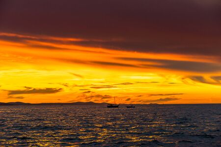 Dramatic sky with sunset over the sea, landscape from the beach in Zadar, Dalmatia, Croatia, Europe Banco de Imagens