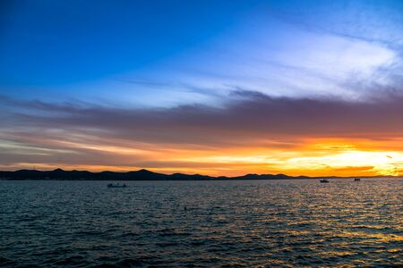 Background with landscape of sunset over sea, scenic view from beach in Zadar, Dalmatia, Croatia, Europe Banco de Imagens