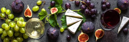 Glasses of wine and food. Fruit and cheese: wine snack set, mediterranean appetizer, food banner.