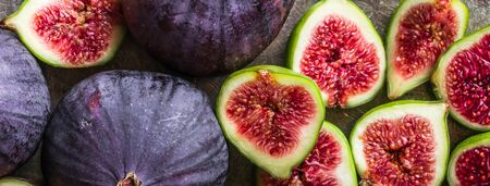 Fresh figs slices. Blue fig fruits, top view.
