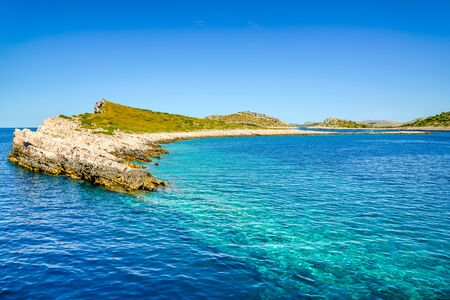 Beautiful seascape bay of Mediterranean Sea, scenic landscape with islands in the sea in Croatia with rocky beach. Vacation travel destination.