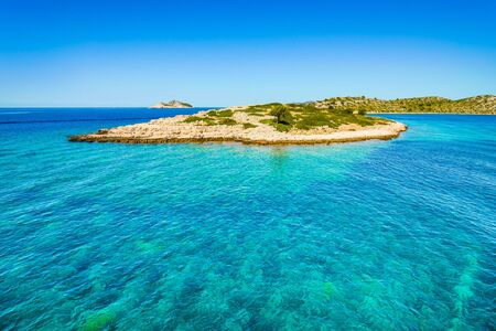 Paradise island in the sea, Mediterranean landscape - Adriatic Sea with turquoise crystal clear water surrounding island beach in Croatia. Vacation travel destination in Dalmatia.