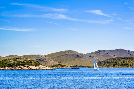 Sailboat in the sea, yacht sailing on Adriatic. Active vacation on the Mediterranean Sea, Croatia, Dalmatia