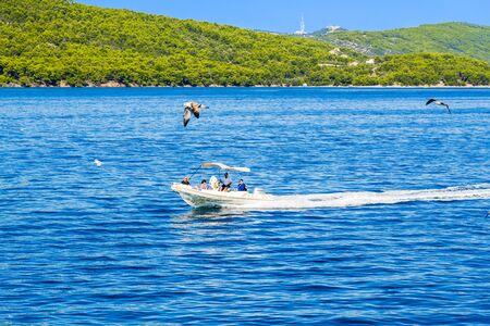 Kornati near Zadar, Croatia - AUG 18, 2019: Scenic view of bay Mediterranean Sea and luxury motor boat at the coast of blue lagoon of paradise island in Dalmatia, Croatia, Europe