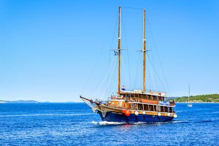 Archipelago Kornati, near Zadar, Dalmatia, Croatia - AUG 18, 2019: Sail boat in the sea. Cruise yacht or sailboat, sailing in the sea. Yachting, luxury vacation and travel concept.