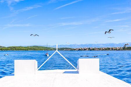 Boat deck, wooden front of the yacht sailing on sea. Cruise near coast of Zadar, Croatia, Dalmatia