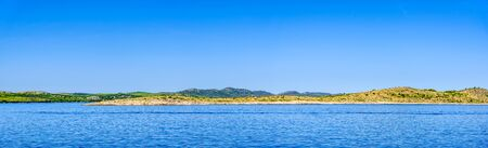 Panorama of Sea and Croatian coast, scenic view during the cruise in the Adriatic Sea with rocky beach in Croatia. Vacation and travel concept