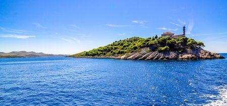 Croatian island with lighthouse on Vela Sestrica near Kornati, Adriatic Sea, Croatia, panorama. Vacation travel concept.