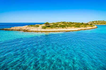 Scenic view of mediterranean lagoon with turquoise water. Adriatic Sea, croatian island and beach, Croatia, vacation travel concept.