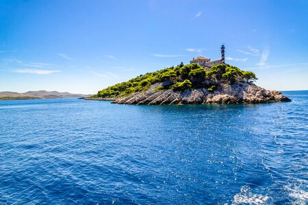Croatian island with lighthouse on Vela Sestrica near Kornati, Adriatic Sea, Croatia, panoramic view. Vacation travel concept.