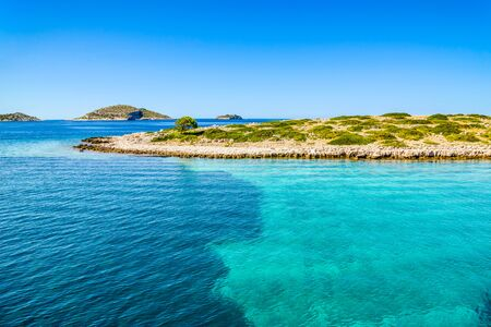 Scenic view of mediterranean lagoon with turquoise water. Adriatic Sea, croatian island coast and beach, Croatia, vacation travel concept.