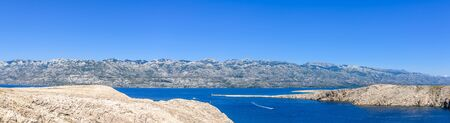 Adriatic Bay and mountains of Pag Island, Croatia, Mediterranean Sea, panorama landscape