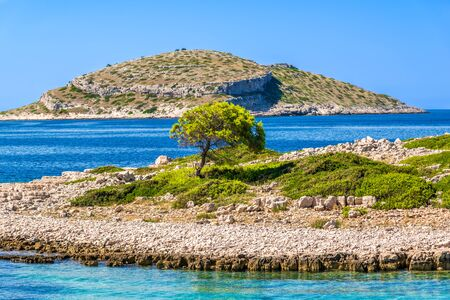 Croatian rocky islands. Mediterranean landscape with blue sky, sea and island. Croatia, vacation travel concept.