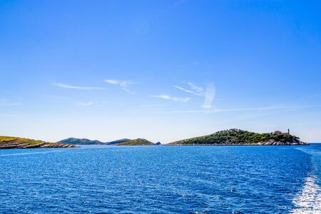Panoramic view of croatian islands in the sea with lighthouse on Vela Sestrica near Kornati, Adriatic Sea, Croatia. Vacation travel concept. Stock fotó - 145697497