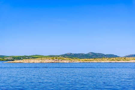 Landscape of Sea and Croatian coast, scenic view during the cruise in the Adriatic Sea with rocky beach in Croatia. Vacation and travel concept Stock fotó