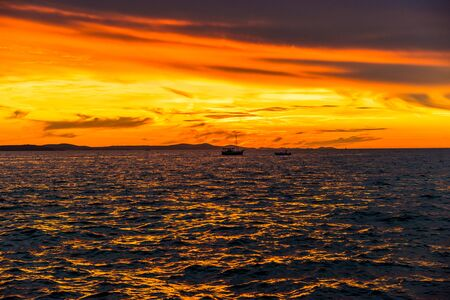 Background with landscape of sunset over sea, view from beach in Zadar, Dalmatia, Croatia