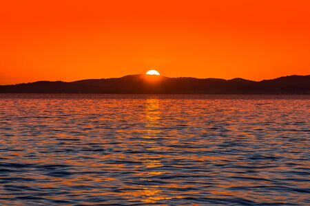 Background with landscape of sunset over sea, scenic view from beach in Zadar, Dalmatia, Croatia Stock fotó
