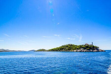 Landscape of croatian island with lighthouse on Vela Sestrica near Kornati, Adriatic Sea, Croatia. Vacation travel concept. Stock fotó