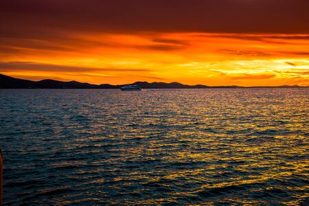 Golden sky with sunset over the sea, landscape from the beach in Zadar, Dalmatia, Croatia, Europe Stock fotó