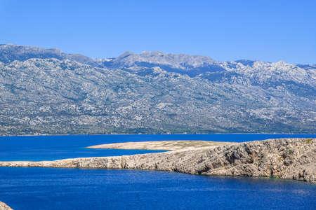 Adriatic Bay, mountains and croatian rocky coast near Pag Island, Mediterranean Sea, Croatia, landscape.