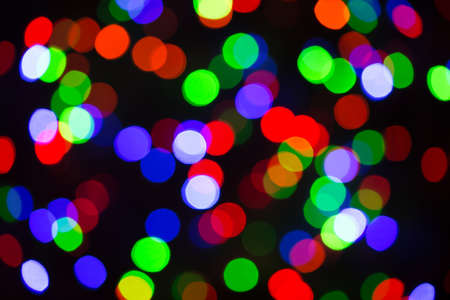 Festive Christmas lights background. Blurred pattern - bokeh with light. Reklamní fotografie