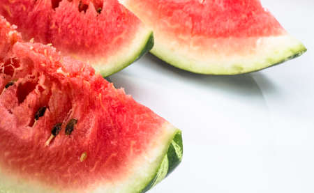 Slices of watermelon isolated on white background. Summer fruit close-up.