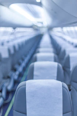 perspective view of empty aircraft seats and lights Stock Photo