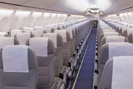 perspective view of empty aircraft seats and lights Imagens