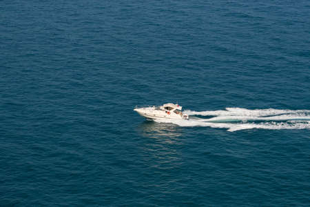 The speedboat traveling fast in the Mediterranean Sea and the trail it left behind