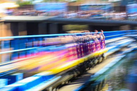 People on roller coaster and panning photography 免版税图像