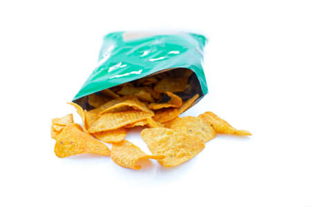 Heap of open packages and corn chips Stock Photo