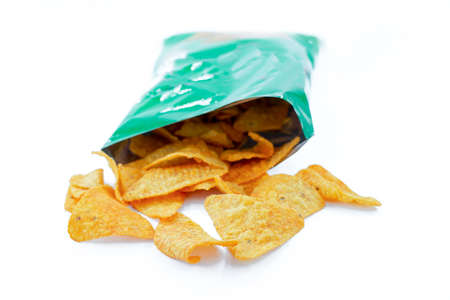 Heap of open packages and corn chip Standard-Bild