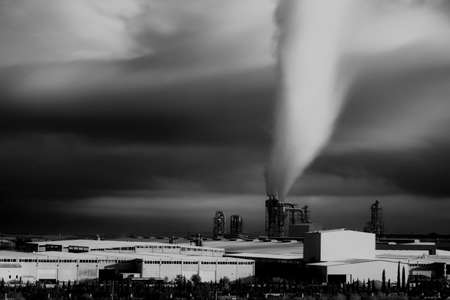 Factory with smoke rising into the sky in Turkey Banco de Imagens
