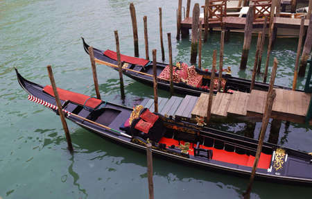 boatman: Boats typical Venetian gondola in the canals of Venice Italy
