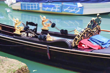 typical: Boats typical Venetian gondola in the canals of Venice Italy