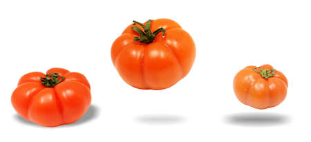 side dish: three tomatoes flying, white background