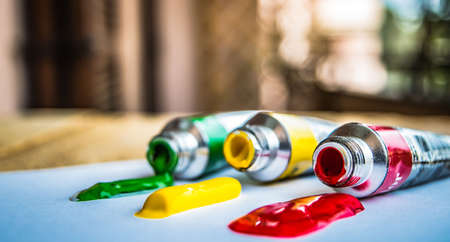 tempera: tempera in red, yellow and green on a light background