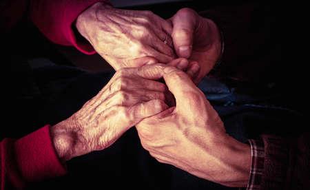 the elderly caregivers: of elderly woman hands, it is helped Stock Photo