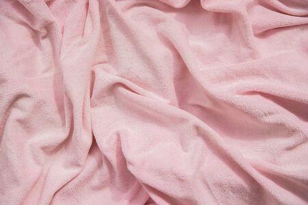Texture fleecy fabric of pink color. 免版税图像