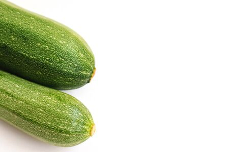 Green zucchini on a white background. The harvest of zucchini.Green vegetables. Vegetarian food.